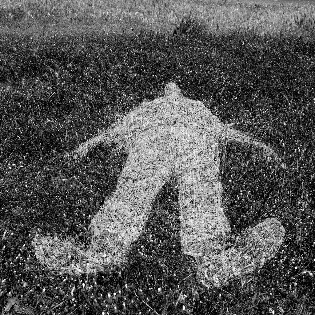 human-figure-outline-imprinted-on-grass-picture-id177395889